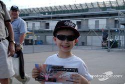 A young Thiago Medeiros fan shows his prize