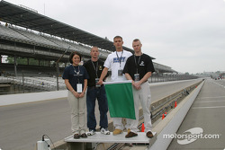 Aubrey Dunleavey, Jennifer Cook ,John McGrath and Zach Howe, all newly inducted members of the US military wave the green flag to start practice