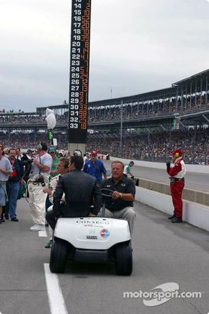 A.J. Foyt, A.J. Foyt IV and Larry Foyt ride to the starting grid