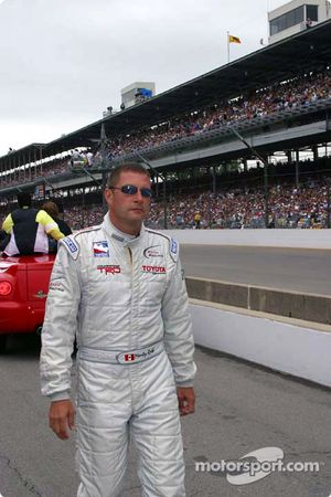 Marty Roth walks to the starting grid