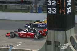 Sarah Fisher leads Buddy Lazier from behind the scoring pylon