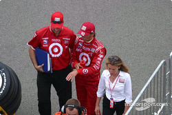 Darren Manning walks back after his accident with Sam Hornish Jr. and Greg Ray