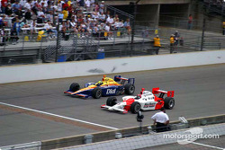 Helio Castroneves passes Buddy Lazier