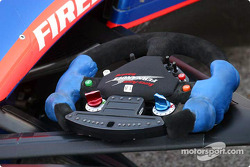 Adrian Fernandez's stearing wheel rest on the front suspension before the race