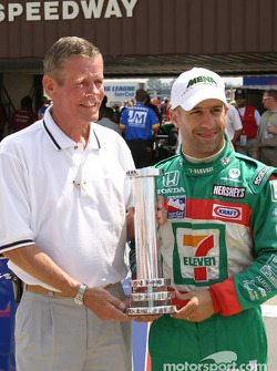 Bobby Unser presents Tony Kanaan with the pole award trophy