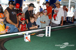 Fans at Michigan International Speedway play slot cars