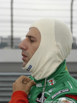 Tony Kanaan dresses for practice