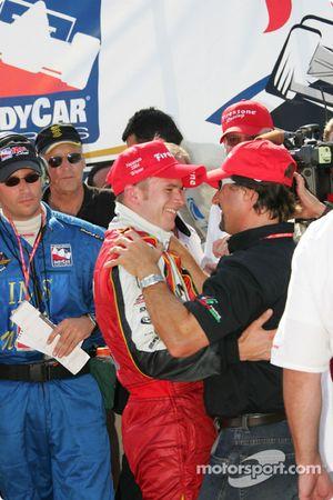 Victory lane: Dan Wheldon celebrates with Michael Andretti