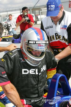 Indy Experience two-seater IndyCar: a guest climbs aboard the car