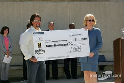 Drink Smart event at The University of Illinois in Chicago: Michael Andretti presents a check