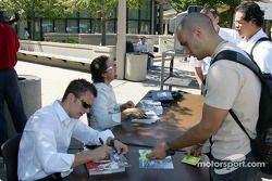Drink Smart event at The University of Illinois in Chicago: Dan Wheldon and Michael Andretti sign au