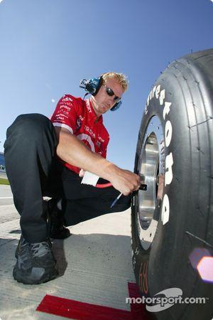 Crew member checks tire pressure