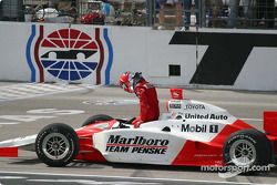 Helio Castroneves gets ready to celebrate
