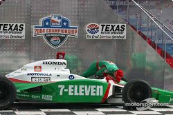 IRL 2004 champion Tony Kanaan kisses his car