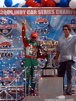 IRL 2004 champion Tony Kanaan celebrates with Tony George