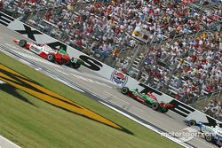 Tony Kanaan and Helio Castroneves fight for the lead