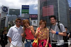 Team Player's drivers Alex Tagliani and Patrick Carpentier hang with some locals in Shibuya, a trendy area of Tokyo.
