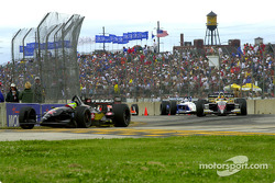 Race action: Cristiano da Matta, Oriol Servia and Michael Andretti