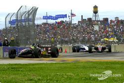 Race action: Cristiano da Matta, Oriol Servia and Michael Andretti