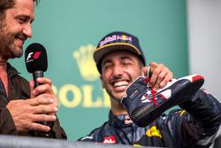 Daniel Ricciardo, Red Bull Racing celebrates on the podium with Gerard Butler, Actor