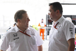 Zak Brown and Eric Boullier, McLaren in the garage.
