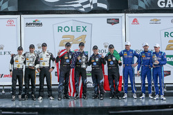 Podium: race winners Ricky Taylor, Jordan Taylor, Max Angelelli, Jeff Gordon, Wayne Taylor Racing, second place Joao Barbosa, Christian Fittipaldi, Filipe Albuquerque, Action Express Racing, third place Marc Goossens, Renger van der Zande, René Rast, Visit