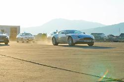 Matt LeBlanc driving an Aston Martin DB11 being pursued by police in Montenegro