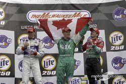 Podio: ganador de la carrera Paul Tracy, con Adrián Fernández y Max Papis