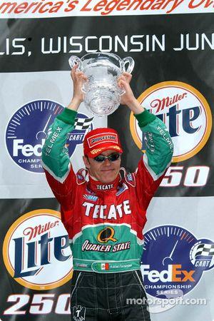 The podium: Adrian Fernandez