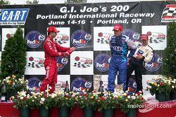 The podium: race winner Cristiano da Matta with Bruno Junqueira and Dario Franchitti
