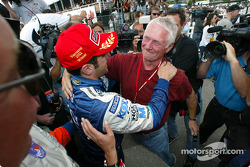Dario Franchitti being congratulated from the late Greg Moore's dad Rick