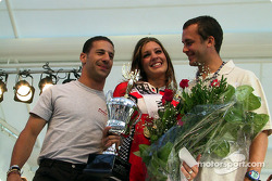 Emotions running high: Miss Molson 2002 with Tony Kanaan and Michel Jourdain Jr.