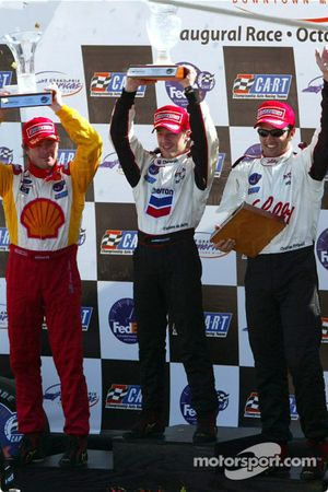 The podium: race winner and 2002 CART Champion Cristiano da Matta with Christian Fittipaldi and Jimm