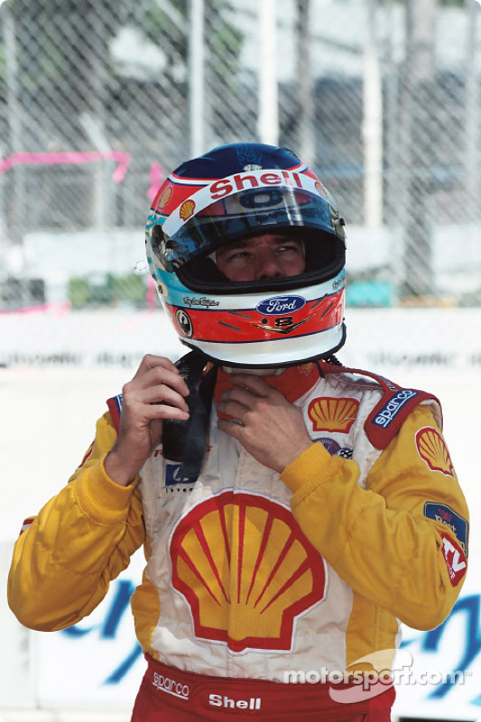 Jimmy Vasser buckles on the helmet