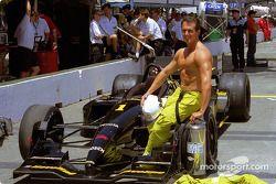 A proud firefighter posing with Cristiano da Matta's car