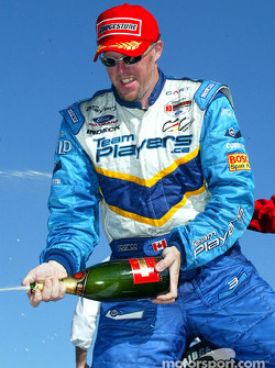 The podium: champagne for race winner Paul Tracy
