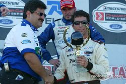 The podium: Bruno Junqueira receives a trophy