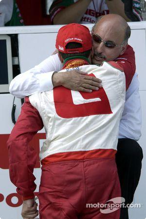 Team owner Bobby Rahal comforts Michel Jourdain Jr. after a mechanical failure