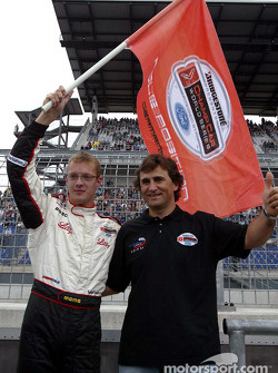Alex Zanardi presents Sébastien Bourdais with the pole position flag