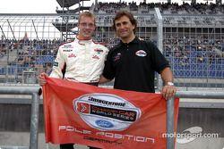 Alex Zanardi presents Sébastien Bourdais with the pole position flag