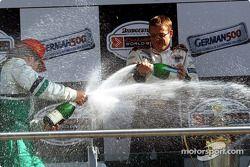 The podium: champagne for race winner Sébastien Bourdais and Mario Dominguez