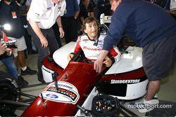Alex Zanardi climbs into the modified Champ car