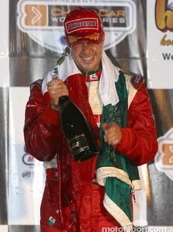 The podium: champagne shower for race winner Michel Jourdain Jr.