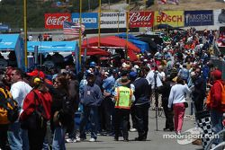 The cold pit area is crowded with crews, media, and others who manage to get a pit pass