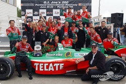 Race winner Adrian Fernandez celebrates with his team