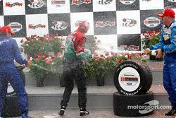 Podium: champagne shower for race winner Adrian Fernandez, Paul Tracy and Alex Tagliani