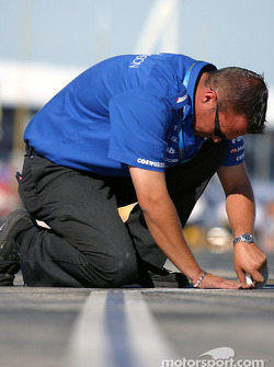 Rocketsports Racing team member prepares pit area