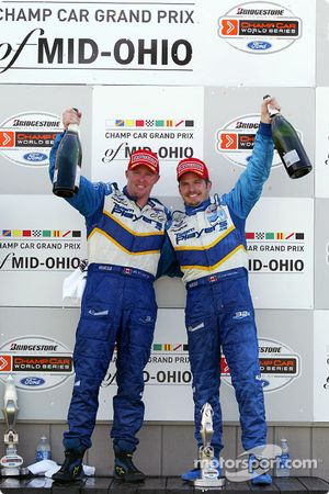 The podium: race winner Paul Tracy with Patrick Carpentier