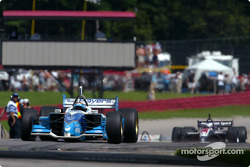 Patrick Carpentier exits pitlane in front of Ryan Hunter-Reay