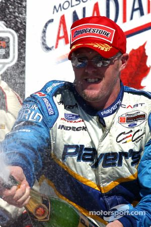 The podium: champagne for Paul Tracy